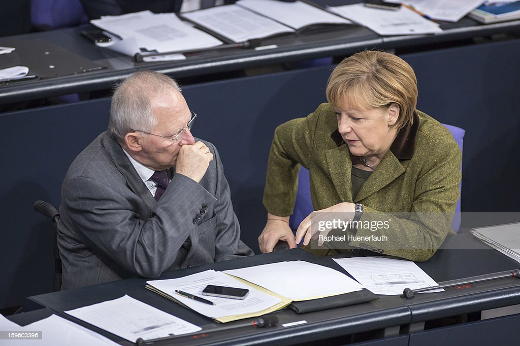German Finance Minister Wolfgang Schaeuble (L) and German Chancellor <a gi-track='captionPersonalityLinkClicked' href=/galleries/search?phrase=Angela+Merkel&family=editorial&specificpeople=202161 ng-click='$event.stopPropagation()'>Angela Merkel</a> (R) during a debate on the Annual Economic Report 2013 of the Federal Government at Reichstag, the seat of the German Parliament (Bundestag), on January 17, 2013 in Berlin, Germany. German Economics Minister Philipp Roesler warned that a short-term deal with the euro crisis through inflation, stating that it's not 'A price we are not willing to pay - the price of monetary stability' in his inaugural speech to the annual economic report in parliament. Merkel's Christian Democratic Union (CDU) will face an electoral test this Sunday as voters go to the polls in Lower Saxony.