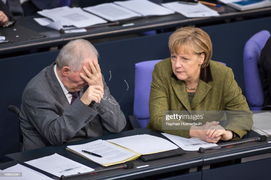 German Finance Minister Wolfgang Schaeuble (L) and German Chancellor <a gi-track='captionPersonalityLinkClicked' href=/galleries/search?phrase=Angela+Merkel&family=editorial&specificpeople=202161 ng-click='$event.stopPropagation()'>Angela Merkel</a> (R) attend the debate on the Annual Economic Report 2013 of the Federal Government at Reichstag, the seat of the German Parliament (Bundestag), on January 17, 2013 in Berlin, Germany. German Economics Minister Philipp Roesler warned that a short-term deal with the euro crisis through inflation, stating that it's not 'A price we are not willing to pay - the price of monetary stability' in his inaugural speech to the annual economic report in parliament. Merkel's Christian Democratic Union (CDU) will face an electoral test this Sunday as voters go to the polls in Lower Saxony.