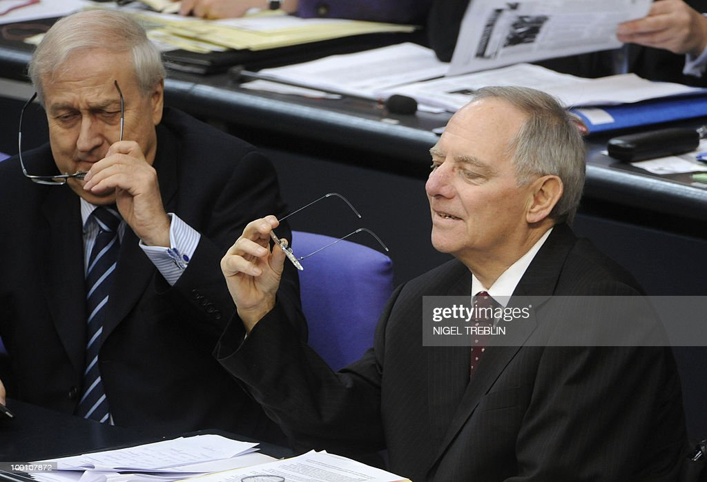 German Finance Minister Wolfgang Schaeuble (R) and German Economy Minister Rainer Bruederle hold their glasses during a debate at the Bundestag, the lower house of parliament, on May 21, 2010 in Berlin. The German parliament is set to unblock its share of a trillion-dollar rescue package for debt-stricken eurozone countries , after Chancellor Angela Merkel warned the euro was 'in danger'.