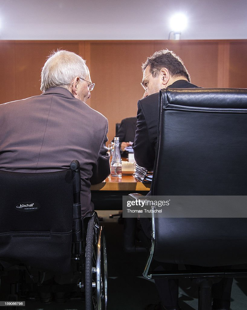 German Finance Minister Wolfgang Schaeuble (L) (CDU) and German Interior Minister Hans-Peter Friedrich (R) (CSU) before the start of the German Cabinet meeting on November 28, 2012 in Berlin, Germany.