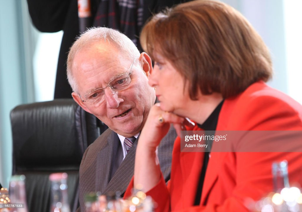 German Finance Minister Wolfgang Schaeuble (L) and German Justice Minister <a gi-track='captionPersonalityLinkClicked' href=/galleries/search?phrase=Sabine+Leutheusser-Schnarrenberger&family=editorial&specificpeople=3026148 ng-click='$event.stopPropagation()'>Sabine Leutheusser-Schnarrenberger</a> speak to one another as they arrive for the weekly German federal cabinet meeting on February 27, 2013 in Berlin, Germany. High on the morning's agenda was discussion of the country's annual report on disarmament as well as of potential modifications to a law on employment rights for foreigners.