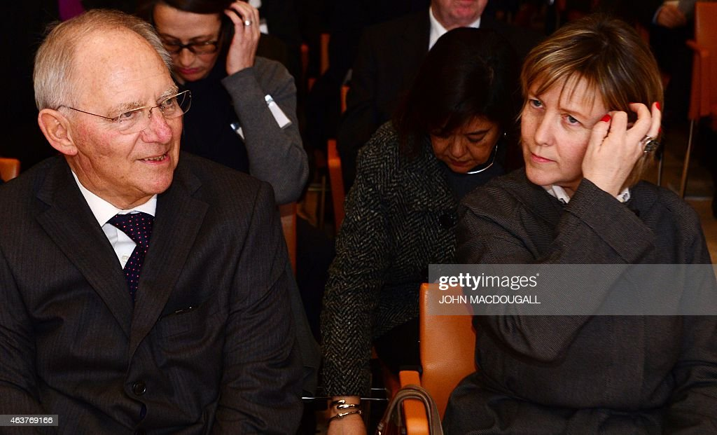 German Finance Minister Wolfgang Schaeuble (L) and his Portuguese counterpart Maria Luis Albuquerque attend the event 'Strengthening Of The European Economy' of the Bertelsmann Foundation in Berlin, on February 18, 2015. The foundation focuses on researching, publishing and stimulating public debate on political, social, economic, educational, cultural and health-related issues. AFP PHOTO / JOHN MACDOUGALL