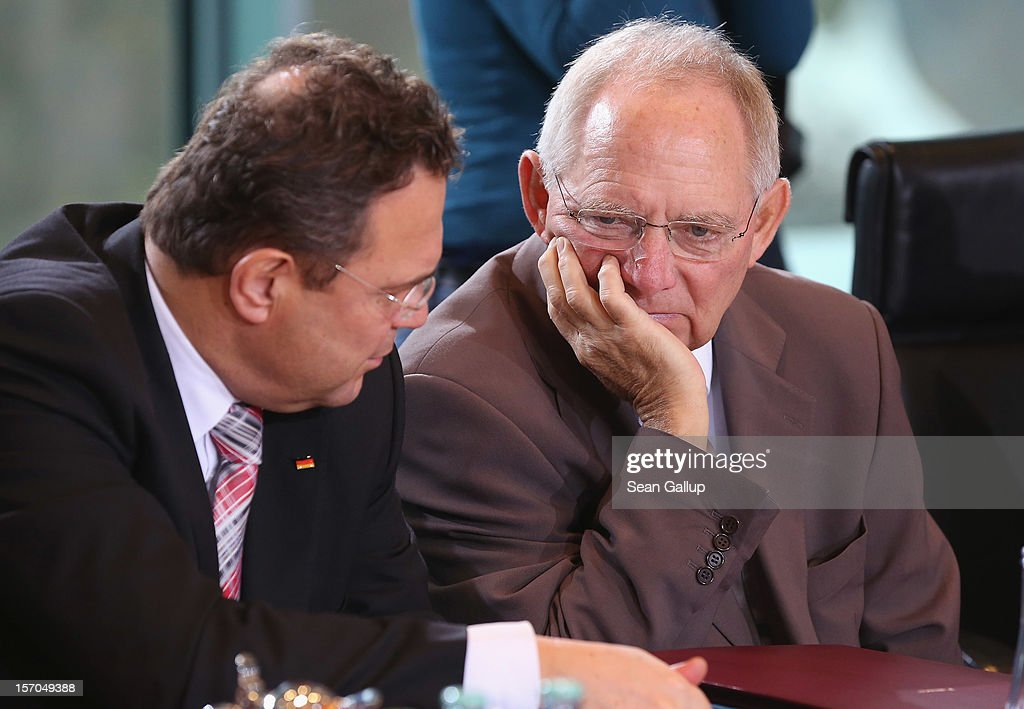 German Finance Minister Wolfgang Schaeuble (R) and Interior Minister Hans-Peter Friedrich chat prior to the weekly German government cabinet meeting on November 28, 2012 in Berlin, Germany. High on the morning's agenda was changes to the country's pension system.