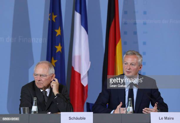German Finance Minister Wolfgang Schaeuble and new French Finance Minister Bruno Le Maire speak to the media following talks on May 22 2017 in Berlin...