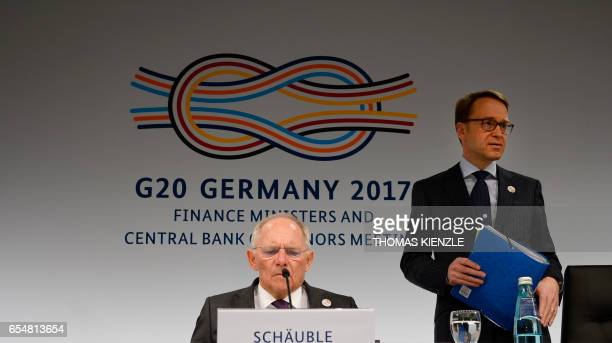 German Finance Minister Wolfgang Schaeuble and president of the German Central Bank Jens Weidmann attend a press conference after the G20 Finance...
