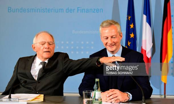 German Finance Minister Wolfgang Schaeuble and the new French Economy minister Bruno le Maire prepare to give a press conference on May 22 2017 in...