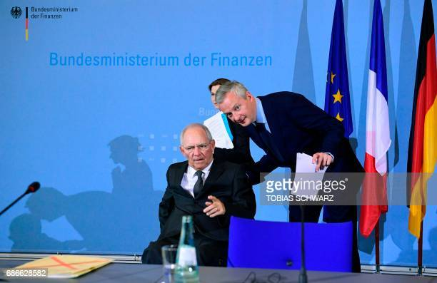 German Finance Minister Wolfgang Schaeuble and the new French Economy minister Bruno le Maire arrive to give a press conference on May 22 2017 in...