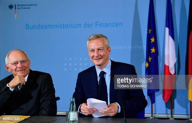 German Finance Minister Wolfgang Schaeuble and the new French Economy minister Bruno le Maire give a press conference on May 22 2017 in Berlin / AFP...