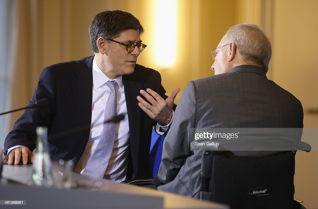 German Finance Minister Wolfgang Schaeuble (R) and U.S. Treasury Secretary Jack Lew chat after speaking to the media following talks at the Finance Ministry on January 8, 2014 in Berlin, Germany. Lew urged the German government to do more to stimulate domestic demand. Germany has a high export surplus that critics charge does not benefit the world economy.