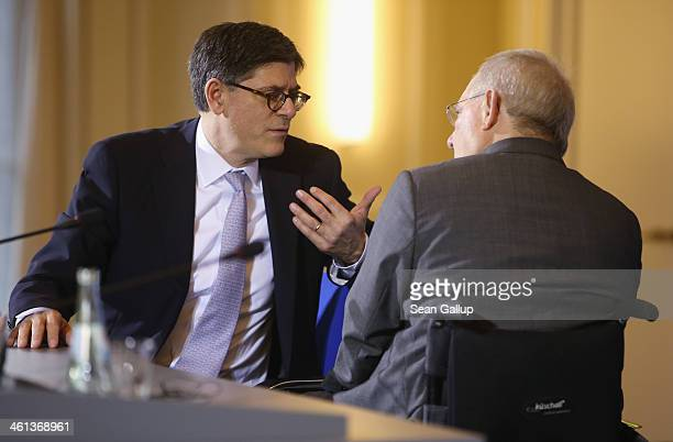 German Finance Minister Wolfgang Schaeuble and US Treasury Secretary Jack Lew chat after speaking to the media following talks at the Finance...