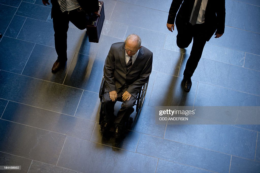 German Finance Minister Wolfgang Schaeuble arrives at Jakob-Kaiser-Haus at the German parliament for preliminary talks between German Chancellor Angela Merkel's conservative CDU/CSU union and the social democratic SPD in Berlin on October 14, 2013. The exploratory talks with the left-leaning ecologist party are part of Merkel's hunt for a governing partner after her conservatives won September 22 elections but fell short of a ruling majority.