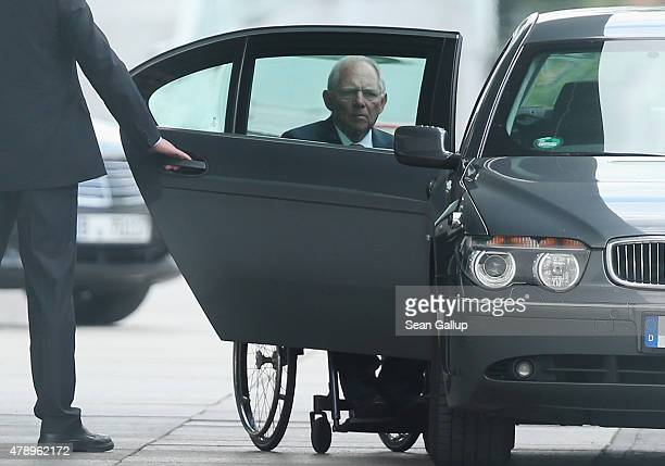 German Finance Minister Wolfgang Schaeuble arrives at the Chancellery for an extraordinary meeting with German Chancellor Angela Merkel and the...
