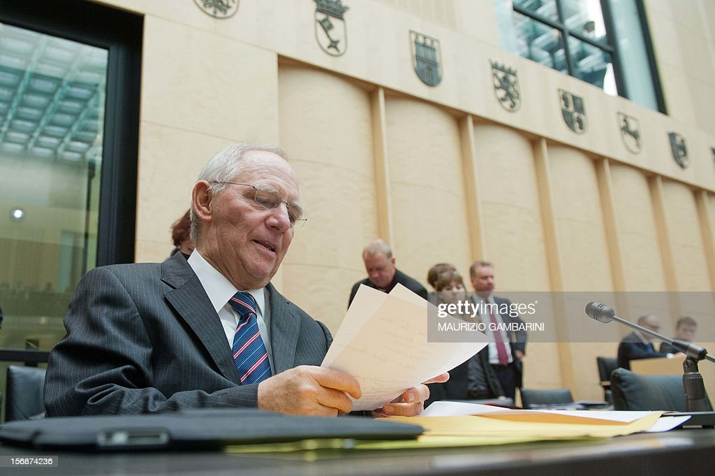 German Finance Minister Wolfgang Schaeuble attends a meeting of the Bundesrat (Federal Council) in Berlin, on November 23, 2012. German lawmakers in the upper house of parliament rejected on Friday a deal on the taxation of German assets parked in Swiss bank accounts. AFP Photo / MAURIZIO