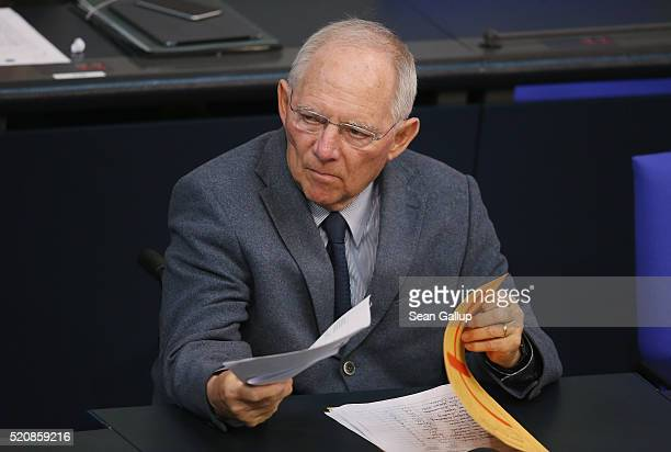 German Finance Minister Wolfgang Schaeuble attends debates at the Bundestag during an extraordinary discussion over foreign tax havens following...