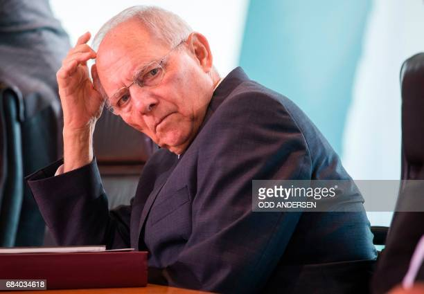 German finance minister Wolfgang Schaeuble attends the weekly cabinet meeting at the Chancellery in Berlin on May 17 2017 / AFP PHOTO / Odd ANDERSEN