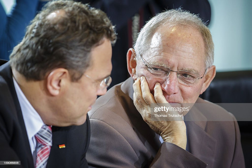 German Finance Minister Wolfgang Schaeuble (R) CDU and German Interior Minister Hans-Peter Friedrich (L) CSU before the start of the German Cabinet meeting on November 28, 2012 in Berlin, Germany.