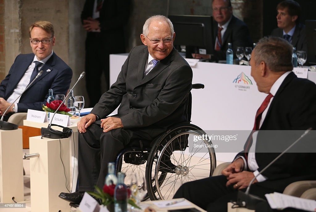 German Finance Minister Wolfgang Schaeuble (C) chats with former U.S. Secretary of the Treasury <a gi-track='captionPersonalityLinkClicked' href=/galleries/search?phrase=Lawrence+Summers&family=editorial&specificpeople=224698 ng-click='$event.stopPropagation()'>Lawrence Summers</a> (R) as <a gi-track='captionPersonalityLinkClicked' href=/galleries/search?phrase=Jens+Weidmann&family=editorial&specificpeople=6917233 ng-click='$event.stopPropagation()'>Jens Weidmann</a> (L), Governor of Germany's Bundesbank, looks on at a symposium during a meeting of finance ministers of the G7 group of nations on May 28, 2015 in Dresden, Germany. The G7 finance ministers are meeting ahead of the upcoming G7 summit at Schloss Elmau in June.