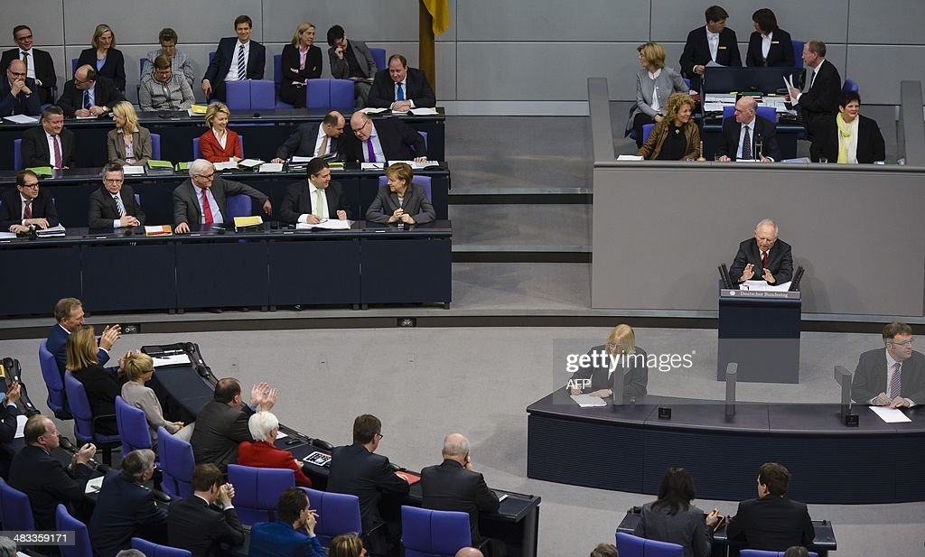 German Finance Minister Wolfgang Schaeuble delivers a speech to present his draft budget for 2014 to lawmakers during a plenary session at the lower...