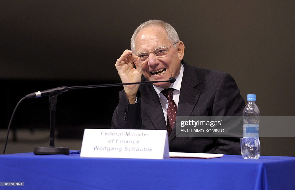 German Finance Minister Wolfgang Schaeuble gestures as he speaks during a seminar on the future of Europe at the University of Tampere on November 7, 2011.