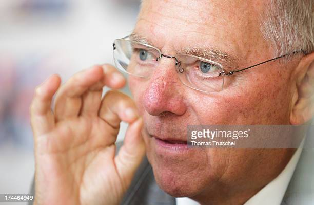 German Finance Minister Wolfgang Schaeuble gestures during an interview on July 23 2013 in Berlin Germany