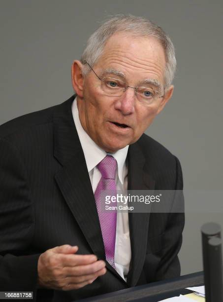 German Finance Minister Wolfgang Schaeuble gives a government statement prior to debates over EU finanical aid to Cyprus at the Bundestag on April 18...