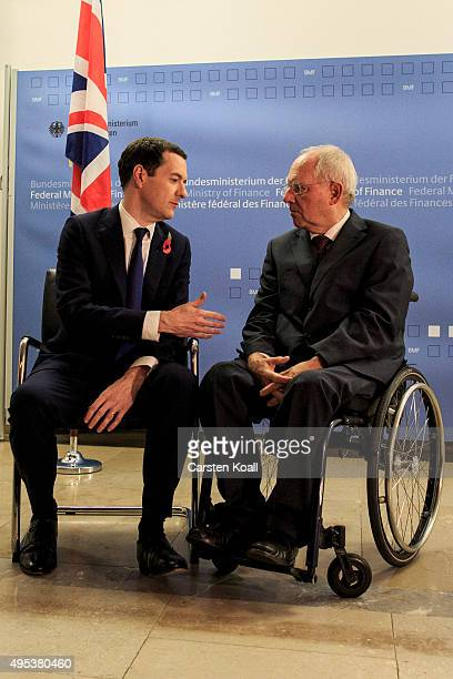 German Finance Minister Wolfgang Schaeuble greets British Chancellor of the Exchequer George Osborne upon Osborne's arrival at the Ministry of...