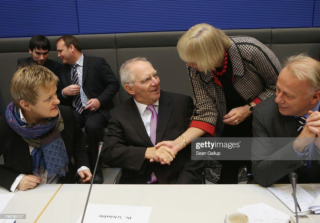 German Finance Minister Wolfgang Schaeuble (C) greets German Greens Party co-Chairwoman <a gi-track='captionPersonalityLinkClicked' href=/galleries/search?phrase=Claudia+Roth&family=editorial&specificpeople=235978 ng-click='$event.stopPropagation()'>Claudia Roth</a> as party members Reneta Kuenast (L) and Juergen Trittin look on at a meeting of the Greens Party Bundestag faction prior to continued debates over the 2013 federal budget on November 21, 2012 in Berlin, Germany. Bundestag members are debating the budget over four days this week.