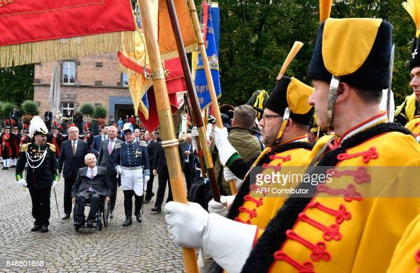 German Finance Minister Wolfgang Schaeuble is accompanied by European Commission President JeanClaude Juncker and BadenWuerttemberg's regional leader...