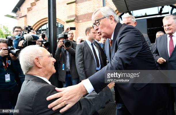 German Finance Minister Wolfgang Schaeuble is greeted by European Commission President JeanClaude Juncker as he arrives for a reception to celebrate...