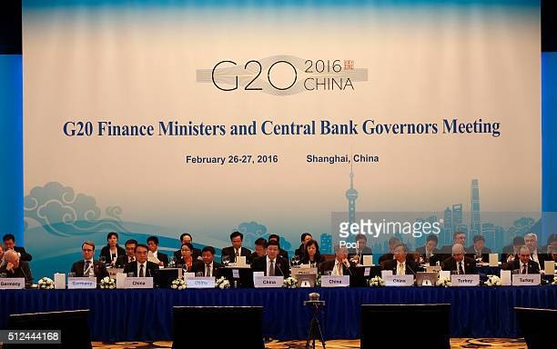 German Finance Minister Wolfgang Schaeuble Jens Weidmann chief of Germany's Federal Bank 'Bundesbank' unidentified Chinese official Chinese Deputy...