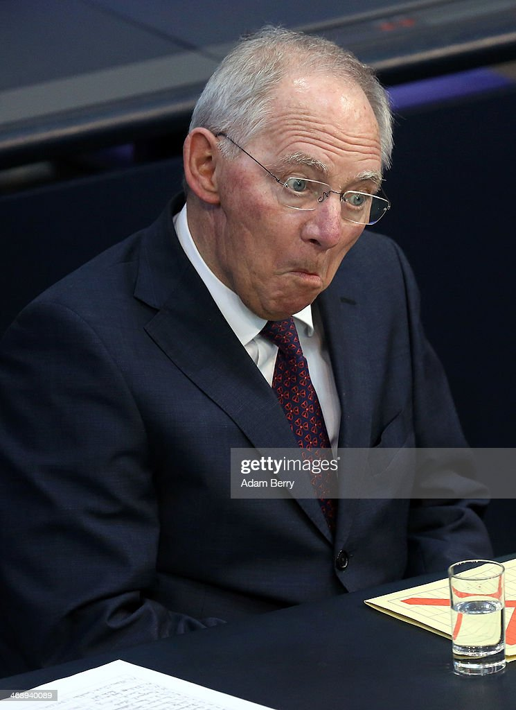 German Finance Minister Wolfgang Schaeuble makes a face at a colleague in the Bundestag, or seat of the German federal Parliament, on February 12, 2014 in Berlin, Germany. Citing strong domestic demand, the German government raised an earlier 2014 economic growth forecast for the country from 1.7% to 1.8%.