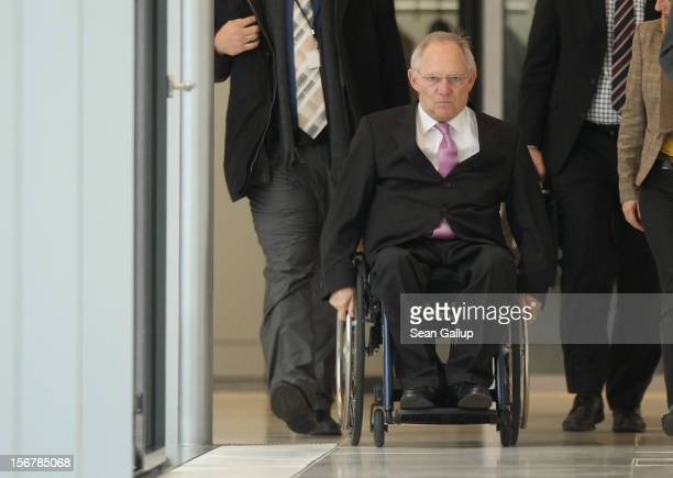 German Finance Minister Wolfgang Schaeuble makes the rounds between the various political party factions at the Bundestag prior to continued debates...