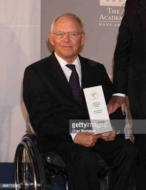German Finance Minister Wolfgang Schaeuble receives the 2017 Henry A Kissinger Prize from Henry Kissinger at the American Academy in Berlin on June...