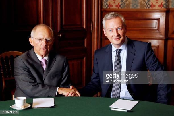 German Finance Minister Wolfgang Schaeuble shakes hands with French Economy Minister Bruno Le Maire during an annual FrancoGerman Summit in Paris on...