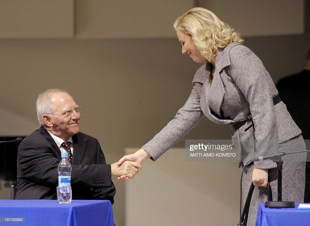 German Finance Minister Wolfgang Schaeuble shakes hands with Jutta Urpilainen, head of the finnish socialist-democrat group (SDP) during a seminar on the future of Europe at the University of Tampere on November 7, 2011. AFP PHOTO/LEHTIKUVA / ANTTI AIMO-KOIVISTO