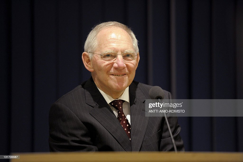 German Finance Minister Wolfgang Schaeuble smiles during a seminar on the future of Europe at the University of Tampere on November 7, 2011.