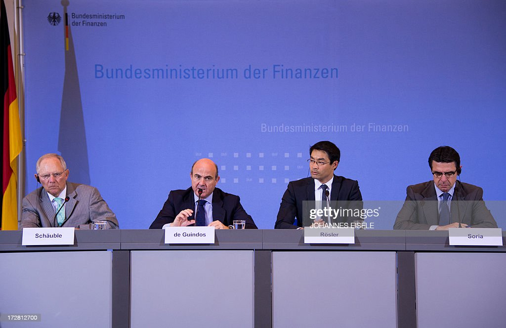 German Finance Minister Wolfgang Schaeuble, Spanish Finance Minister Luis de Guindos, German Economy Minister Philipp Roesler and Spain's Minister for Industry, Energy and Tourism Jose Manuel Soria address a press conference after signing an agreement outlining financial support to Spanish small and medium-sized businesses in Berlin on July 4, 2013. Germany and Spain signed an agreement to boost access to affordable credit for small and medium enterprises in the recession-hit southern European country in a bid to foster growth and create jobs.