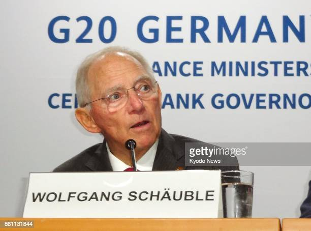 German Finance Minister Wolfgang Schaeuble speaks at a press conference after a twoday Group of 20 financial meeting in Washington on Oct 13 2017 The...