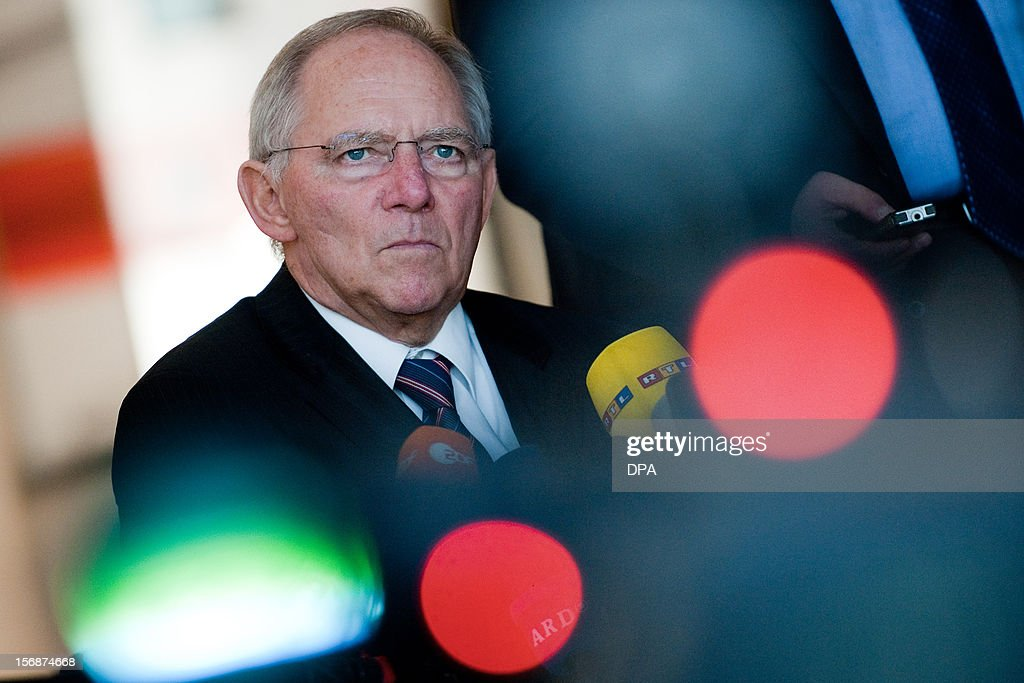 German Finance Minister Wolfgang Schaeuble (C) speaks during a press conference at the Bundestag in Berlin, on November 23, 2012. German lawmakers in the upper house of parliament rejected on Friday a deal on the taxation of German assets parked in Swiss bank accounts.