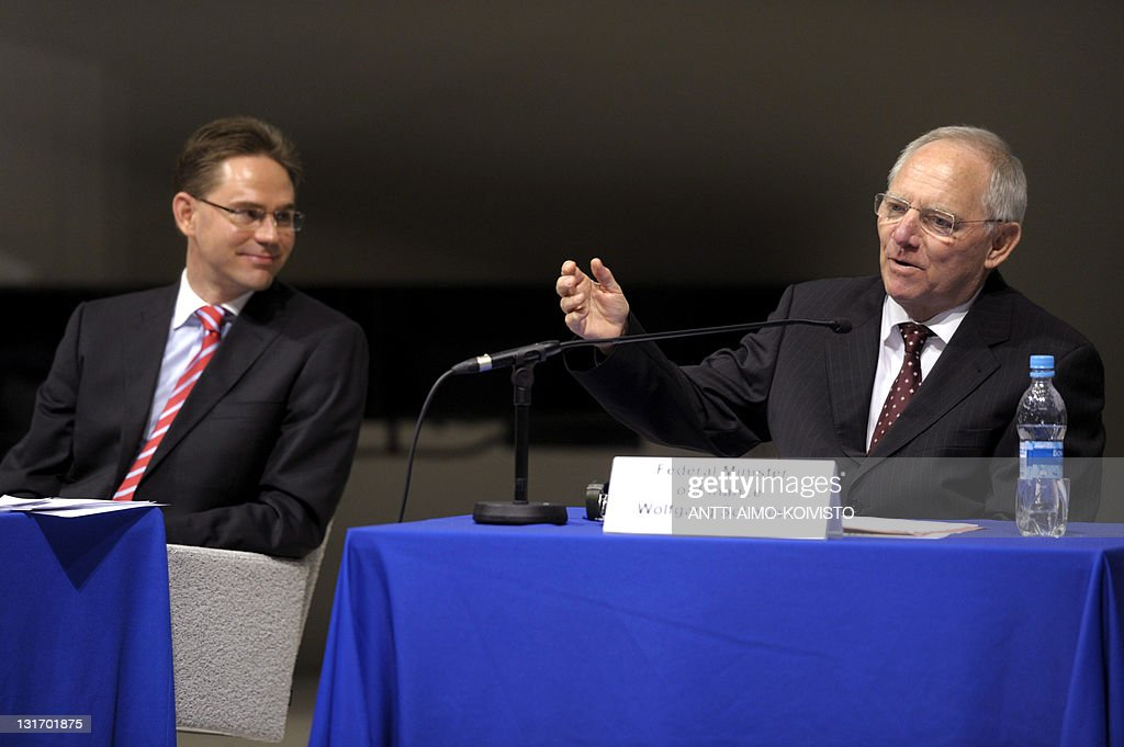 German Finance Minister Wolfgang Schaeuble (R) speaks next to Finland's Prime Minister Jyrki Katainen (L) during a seminar on the future of Europe at the University of Tampere on November 7, 2011.