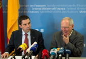 German Finance Minister Wolfgang Schaeuble speaks next to his Portuguese counterpart Vitor Gaspar during a joint press conference after their talks...