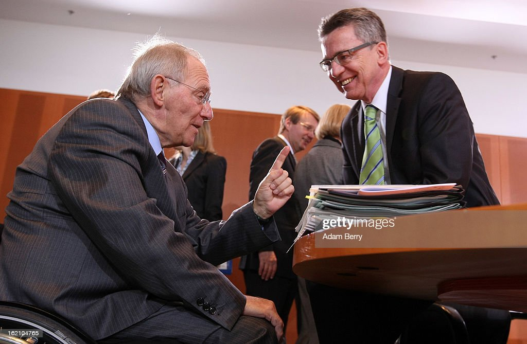 German Finance Minister Wolfgang Schaeuble (L) speaks to German Defense Minister <a gi-track='captionPersonalityLinkClicked' href=/galleries/search?phrase=Thomas+de+Maiziere&family=editorial&specificpeople=618845 ng-click='$event.stopPropagation()'>Thomas de Maiziere</a> as they arrive for the German federal cabinet meeting on February 19, 2013 in Berlin, Germany. High on the cabinet meeting agenda will be Germany's military role in Mali, for which the country has already promised logistical support based on the situation on the ground to help an initial battle against Islamic insurgents. Germany has also pledged two C-160 transport planes as well as backing an EU plan to send 200 military advisers to the African nation.
