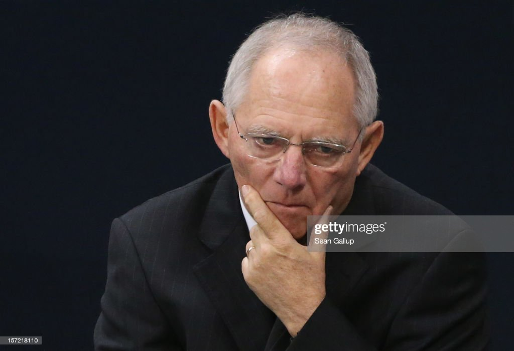 German Finance Minister Wolfgang Schaeuble waits to speak during debates over a financial aid package for stricken Greece at the Bundestag on November 30, 2012 in Berlin, Germany. The Bundestag later approved the measure that will allow the next tranche of financial assistance for Greece.