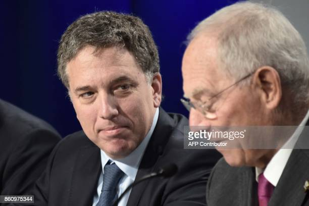 German Finance Minister Wolfgang Schauble and Argentinian Treasury Minister Nicolas Dujovne give a press conference at the World Bank and...