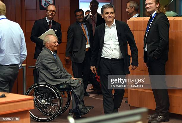 German Finance Minister Wolfgang Schauble and Greece's Finance Minister Euclid Tsakalotos attend an extraordinary Eurogroup meeting on Greece at the...