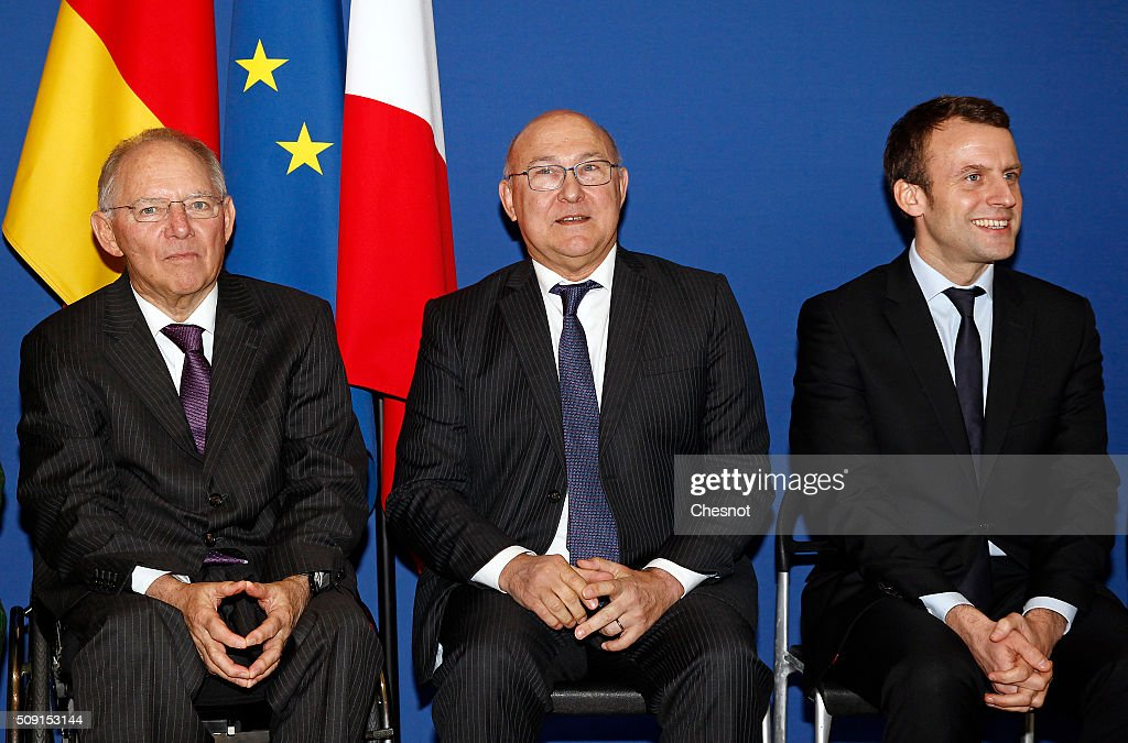German Finance Minister Wolfgang Schauble, French Finance Minister <a gi-track='captionPersonalityLinkClicked' href=/galleries/search?phrase=Michel+Sapin&family=editorial&specificpeople=668944 ng-click='$event.stopPropagation()'>Michel Sapin</a> and <a gi-track='captionPersonalityLinkClicked' href=/galleries/search?phrase=Emmanuel+Macron&family=editorial&specificpeople=9899223 ng-click='$event.stopPropagation()'>Emmanuel Macron</a>, French Minister of Economy pose during a photo family at the minister of finances on February 9, 2016 in Paris, France. <a gi-track='captionPersonalityLinkClicked' href=/galleries/search?phrase=Michel+Sapin&family=editorial&specificpeople=668944 ng-click='$event.stopPropagation()'>Michel Sapin</a> meets Wolfgang Schauble for a Franco-German Economic Council.