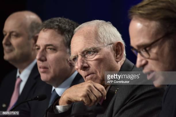 German Finance Minister Wolfgang Schauble with German Bundesbank President Jens Weidman Argentinian Treasury Minister Nicolas Dujovne and Argentinian...
