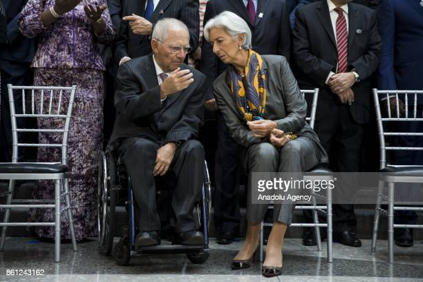 German Finance Minister Wolfgang Schäuble and IMF Managing Director Christine Lagarde talk before the Board of Governors Family Photo during the 2017...
