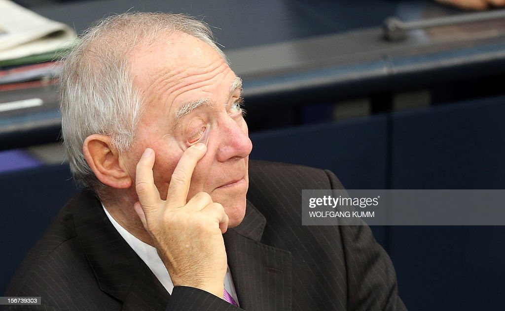 German finiance minister Wolfgang Schaeuble gestures as he attends a debate on November 20, 2012 in Bundestag in Berlin. Gloomy German companies are preparing to slash their workforces next year as the eurozone crisis bites, a survey showed on Monday, with more than one in four firms saying they would cut jobs in 2013. AFP PHOTO/ Wolfgang Kumm/ GERMANY OUT