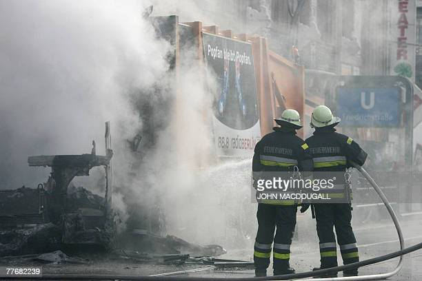 German firefighters douse a garbage dumpster that caught fire on Berlin's main Friedrichstrasse thoroughfare 05 November 2007 The cause of the blaze...